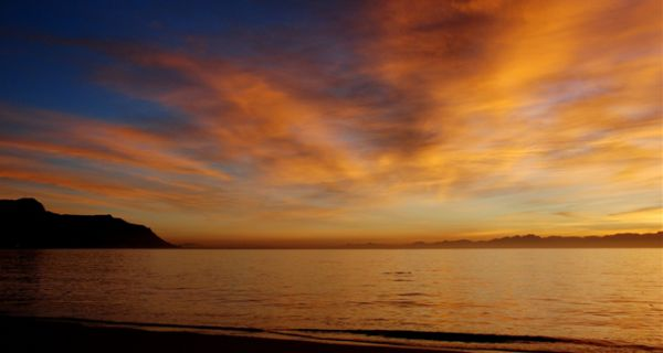 Surnrise over False Bay from the Beach  (photo-Vic Duggan)