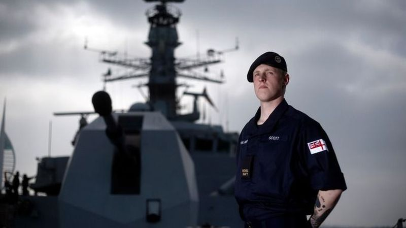 Able seaman Sam Scott models the Royal Navy's new uniform onboard HMS Lancaster in Portsmouth